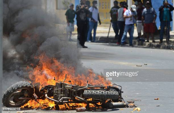 Motorbike set on fire by supporters of Bolivian President Evo Morales burns during clashes with supporters of defeated presidential candidate Carlos...