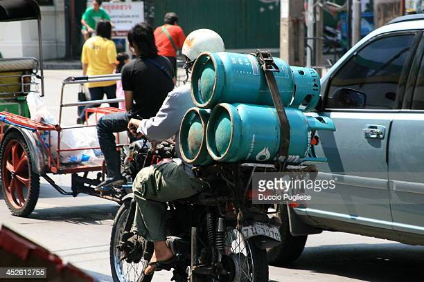 Motorbike transports natural gas in Thailand