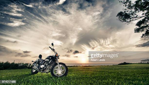 Motorbike with cloudscape, Okinawa, Japan