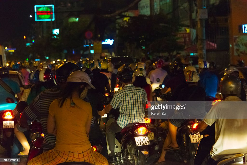 Motorbikes and busy traffic during rush hour : Stock Photo