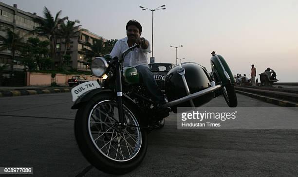 Motorbikes Biker Mehmood Khan does a wheely on a BSA 350 cc at Worli Seaface on Friday