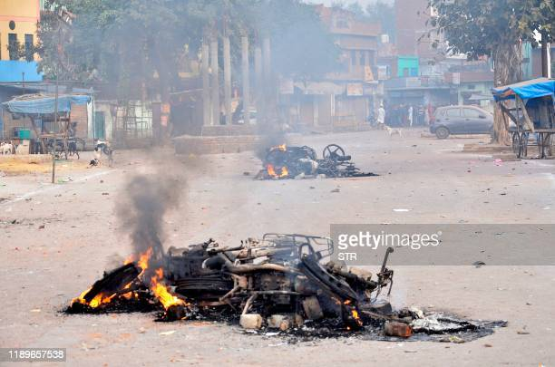 Motorbikes burn after being set on fire during demonstrations against India's new citizenship law in Kanpur on December 20 2019 Five more protesters...