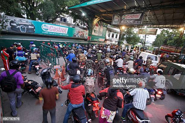 Motorbikes line up at a petrol station in Kathmandu on September 30 2015 Nepalese are facing an acute crisis of petroleum products and other...