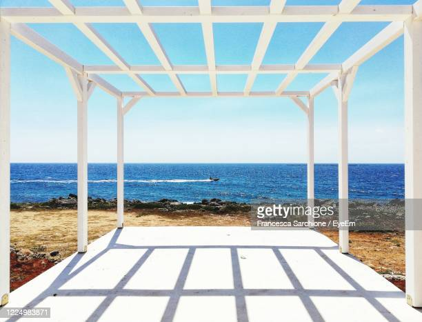 motorboat framed by the patio gazebo - gazebo stock pictures, royalty-free photos & images