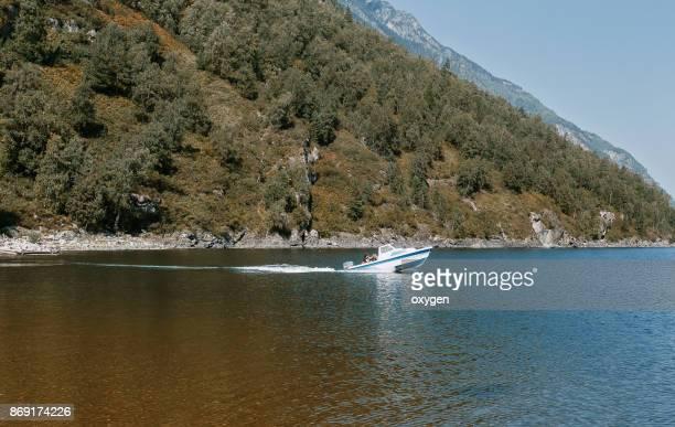Motorboat on Teleckoe lake Altai mountains, Russia