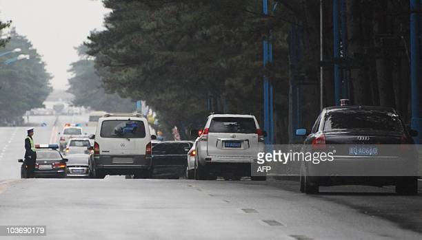 A motorcade beleived to carry North Korean leader Kim JongIl leaves the Nanhu hotel in Changchun Jilin on August 28 2010 North Korean leader Kim...