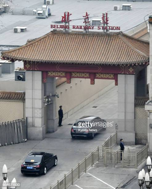A motorcade believed to be carrying a highranking North Korean official enters Beijing train station on March 27 2018 According to media reports...