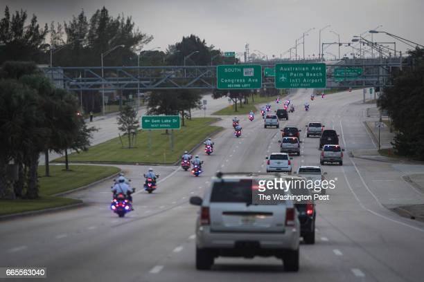 Motorcade carrying President-elect Donald Trump, his wife Melania Trump, and son Barron Trump makes its way to the airport as he heads back to New...