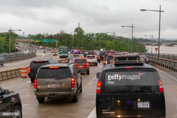 A motorcade carrying United States President Donald J Trump navigates rush hour traffic in Washington DC as it returns to the White House following...