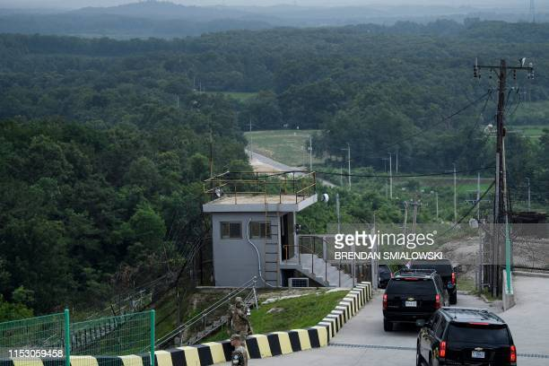 A motorcade departs with US President Donald Trump after a visit to an observation point in the Demilitarized Zone June 30 in Panmunjom Korea