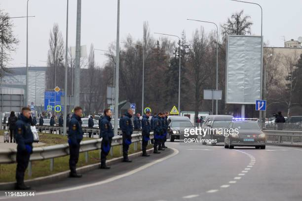 Motorcade of hearses carrying the bodies of victims at the Boryspil International Airport during the memorial ceremony. Bodies of 9 crew members and...
