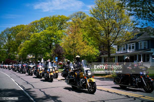 A motorcade rides with the procession during the funeral of Glen Ridge Police Officer Charles Roberts after he passed away from the coronavirus on...
