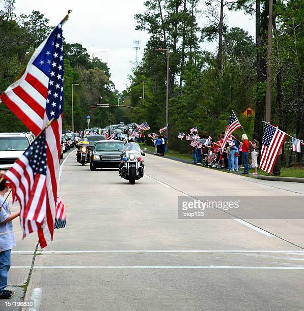 Motorcade with police officers and flags. Parade, funeral. USA.