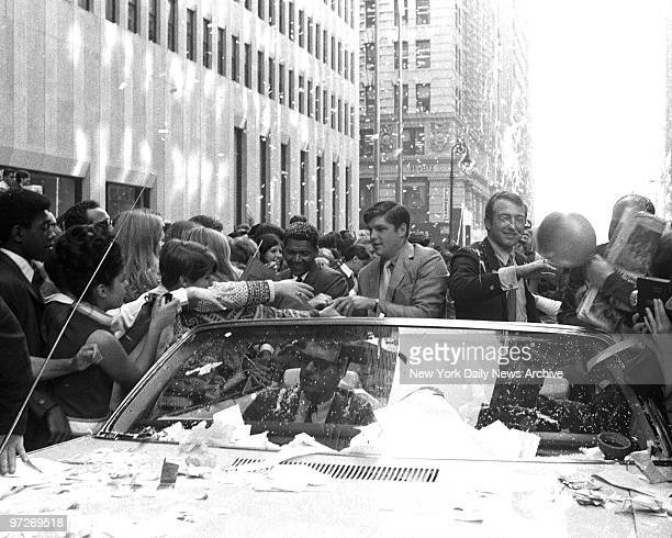 Motorcade with Tom Seaver [l] and Jerry Koosman going up Broadway at the ceremony and parade for the New York Mets' after they defeated the Baltimore...