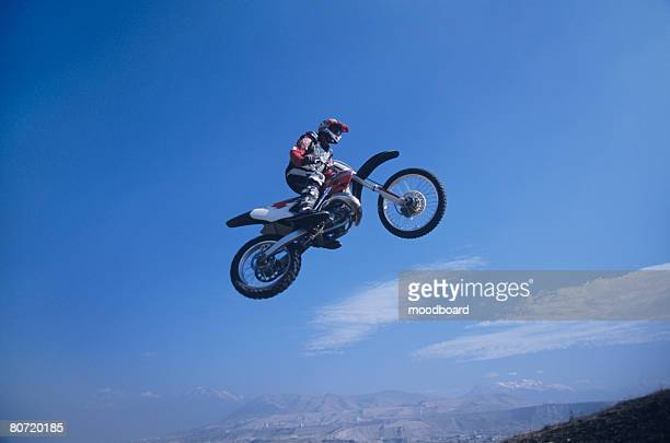motorcross rider jumping - scrambling stock pictures, royalty-free photos & images