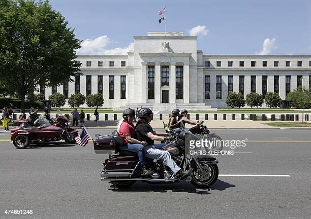 Motorcycclist participating in the The Rolling Thunder First Amendment Demonstration Run ride by the Federal Reserve Building in Washington DC on May...