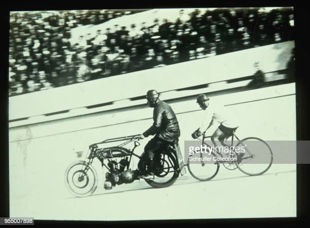 Motorcycle against bicycle race A bicycle races a motorcycle during a race of speed at a motorcycle track in the USSR 19301934 USSR