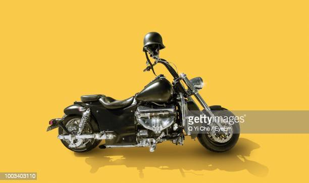Motorcycle Against Yellow Background
