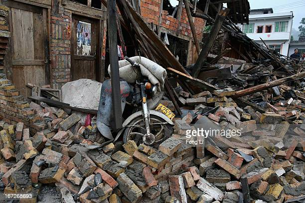 Motorcycle and rubble from a collapsed building after a strong earthquake hit Southwest China's Sichuan Province on April 23 2013 in Longmen township...