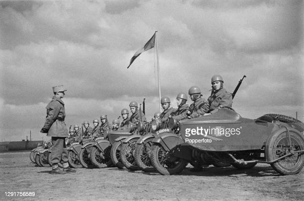 Motorcycle and sidecar unit of Free French troops from a battalion of Chasseurs Alpins moutain forces line up in formation at their base prior to...
