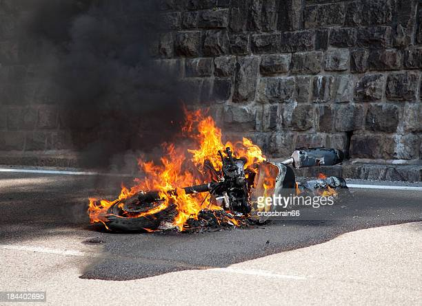 motorcycle burning after accident - motorcycle accident stock pictures, royalty-free photos & images