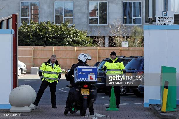 A motorcycle courier arrives at the boardedoff entrance to the Holiday Inn hotel close to Heathrow Airport west of London on March 1 2020 Britain's...