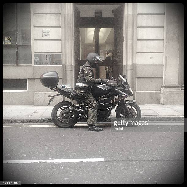 Motorcycle courier, London.