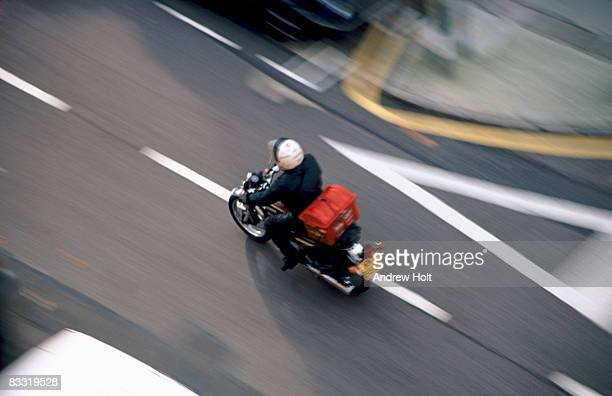 Motorcycle courier or Pizza delivery speeding