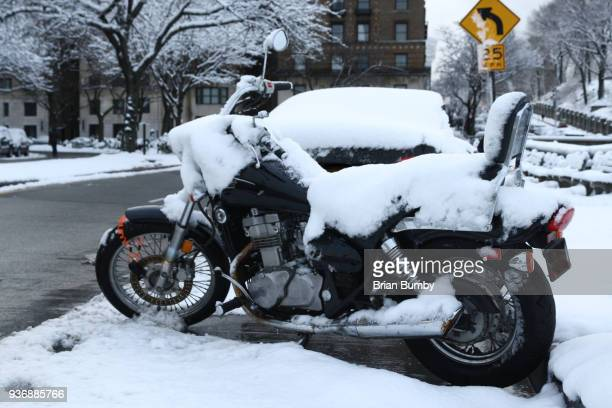 Motorcycle covered in snow