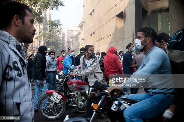 A motorcycle driver waiting to ferry out a fellow protestor On the Fifth day of Violence November 23rd in Cairo Egypt Egyptians continue violent...