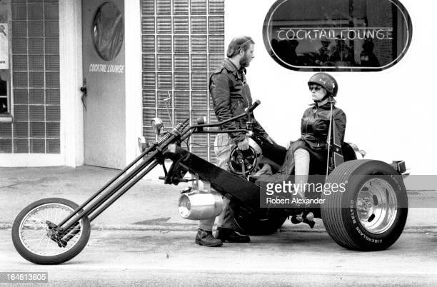 Motorcycle enthusiasts park their 'trike' outside a Daytona Beach Florida bar during the city's annual Bike Week in Daytona Beach Florida...