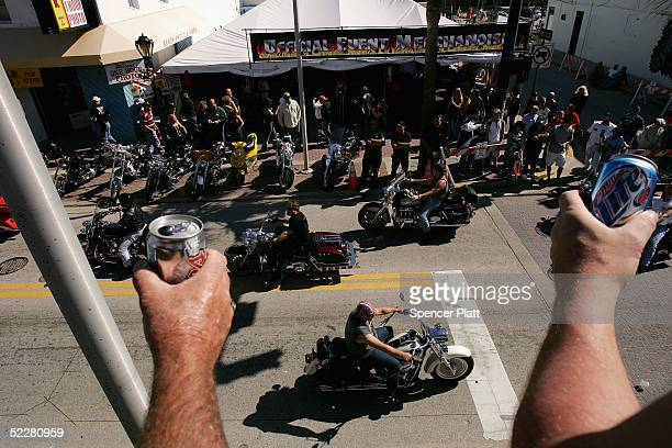 Motorcycle enthusiasts watch the crowds on the street from a bar during Bike Week March 5 2005 in Daytona Beach Florida The 10day 64th annual Bike...