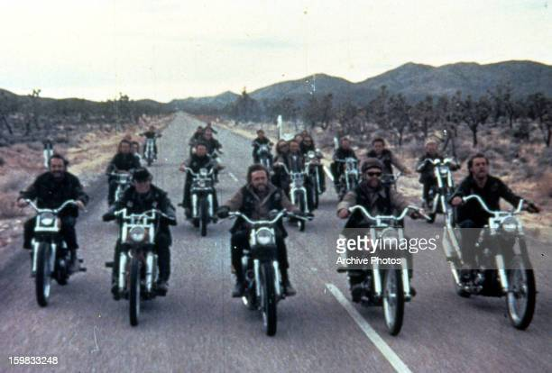 A motorcycle gang rides in a scene from the film 'The Savage Seven' 1968