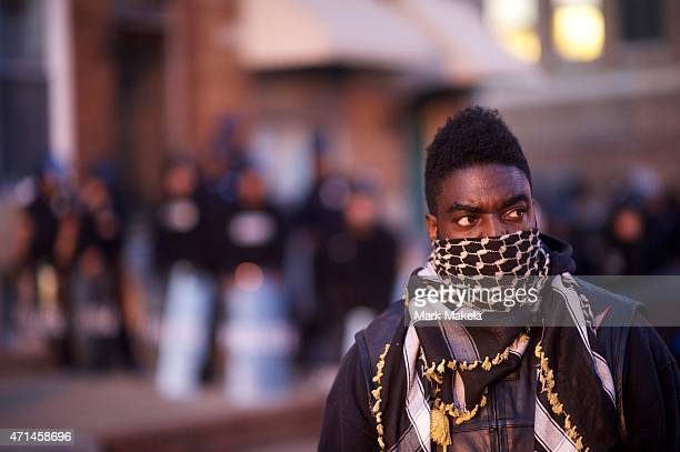 Motorcycle group formed a line in front of the Baltimore riot police the night after citywide riots on April 28, 2015 in Baltimore, Maryland. Freddie...