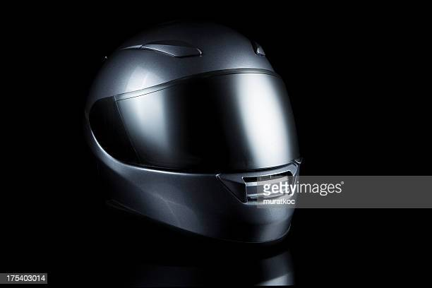 motorcycle helmet on black - crash helmet stock pictures, royalty-free photos & images
