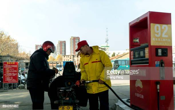 A motorcycle is refueling in a gas station Recently many media reports said that China has launched a timetable for stopping production and sale of...