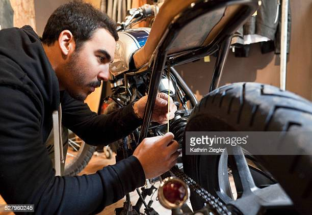 motorcycle mechanic measuring rear dropout