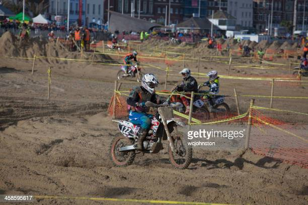 Motorcycle motocross dirt bike race on the beach at Weymouth