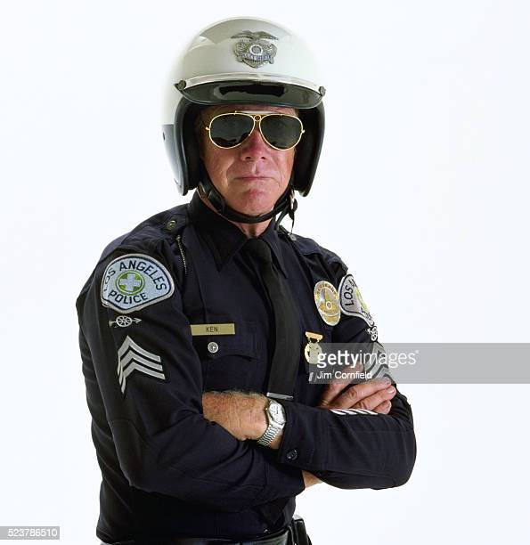 motorcycle officer looking stern - los angeles police department stock pictures, royalty-free photos & images