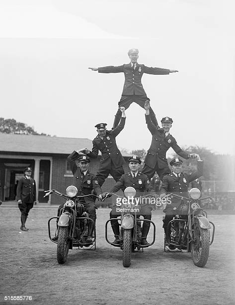 Motorcycle officers reherse a human pyramid stunt at Victory Field for a benefit Police Department Show to be held at Madison Square Garden