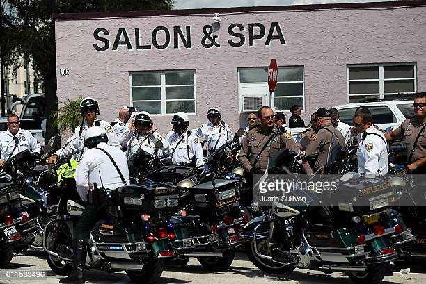 Motorcycle officers who escorted the motorcade of democratic presidential nominee former Secretary of State Hillary Clinton sit outside of Sunrise...