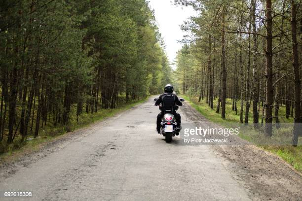 Motorcycle on a road in the forest