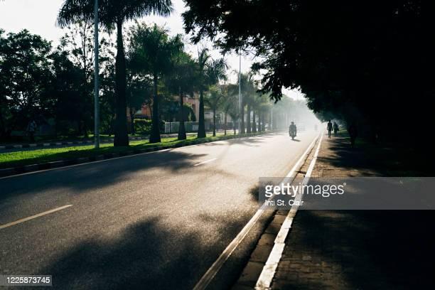 motorcycle on empty road in kigali, rwanda - キガリ ストックフォトと画像