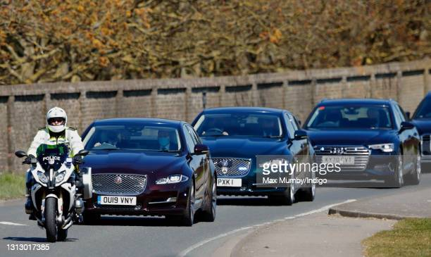 Motorcycle outrider of the Metropolitan Police Special Escort Group leads a convoy of cars carrying Prince Richard, Duke of Gloucester, Prince...