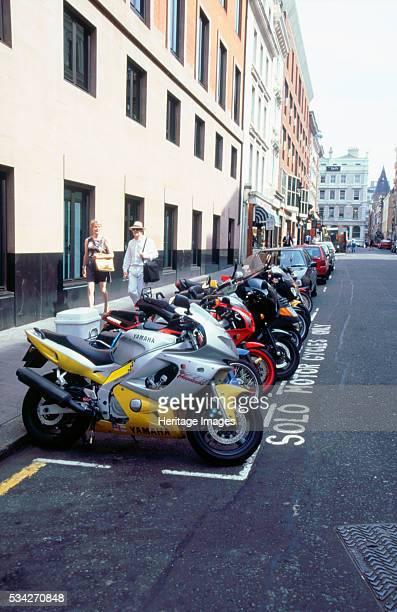 Motorcycle parking bay in London, 2000.