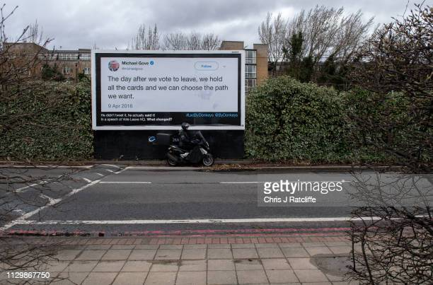 Motorcycle passes a billboard with a quote from Environment Secretary, Michael Gove, on March 11, 2019 in London, United Kingdom. The billboard...