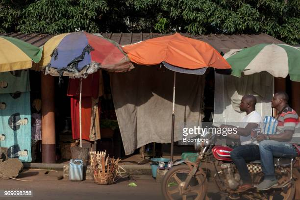 Motorcycle passes by the downtown fruits market in Yaounde, Cameroon, on Tuesday, June 5, 2018. Cameroon adjusted its 2018 budget to 4.69 trillion...