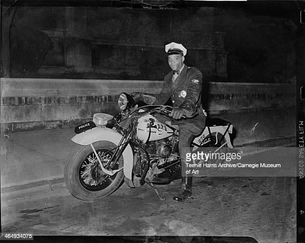 Motorcycle patrolman James Holt posed on police motorcycle no 272 Pittsburgh Pennsylvania October 1945