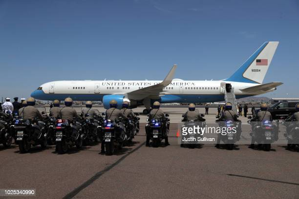 Motorcycle police park in a line as the casket of US Sen John McCain is transferred at Goldwater Air National Guard Base Phoenix Sky Harbor...