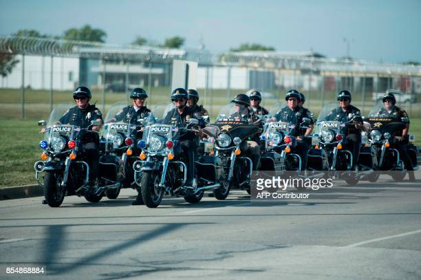 Motorcycle police who escorted US President Donald Trump to Indianapolis International Airport are seen September 27 2017 in Indianapolis Indiana /...